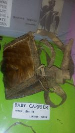 Ancient / olden baby carrier made using animal hide and skin